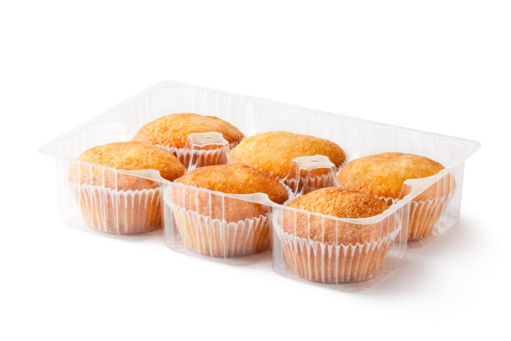 Muffins in retail package. Isolated on a white.