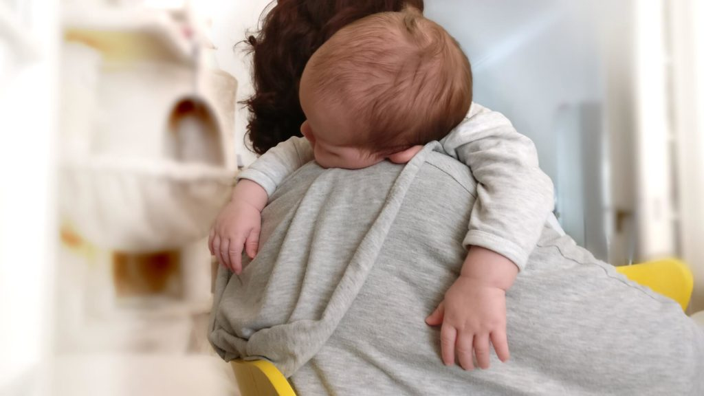 Baby asleep in Mom's arms