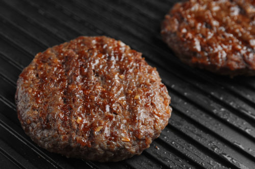 Prepare your own hamburgers on the grill to decrease or eliminate your consumption of fast food or processed food